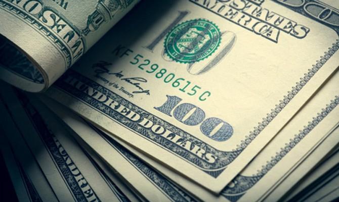 Курс доллара наМосковской бирже превысил отметку в65 руб.