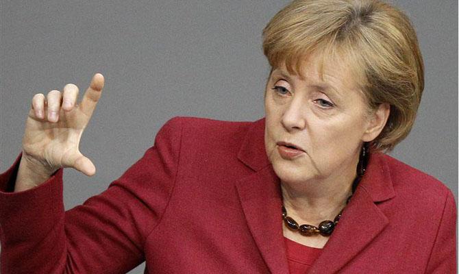 Карточный домик Ангелы Меркель