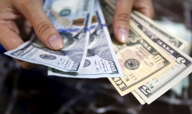 Доллар и русский руб. подорожали перед выходными