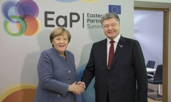 Порошенко иМеркель согласовали шаги повведению миротворцев